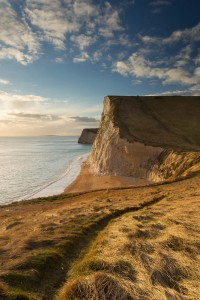 The cliffs of Swyre Head and Bat's Head in the light of the falling sun, on the Jurassic coast, Dorset, England