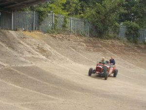 Car speeding along Brooklands track on kids photography course