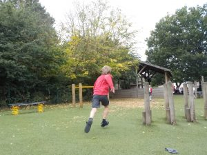 action photography after school club running and playing