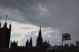 Silhouette of the houses of parliament and england flag