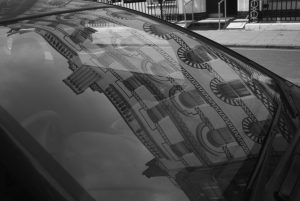 Reflection of building in car windscreen black and white