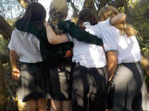 Friends hugging at school friendship