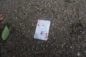Documentary photography in london playing card on the pavement