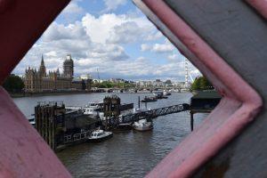 Houses of parliament photograph through gaps in a bridge