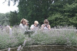 teens photographing flowers on photography course in Richmond