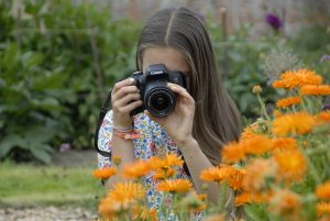 Teen photographing flowers at Scotney Castle
