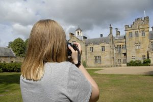 Teen learning photography at Scotney Castle