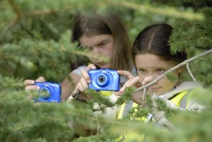 Kids photographing trees at Scotney Castle Kent
