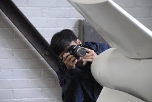 Teen photographing an engine at Brooklands Museum