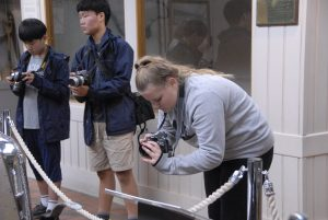 Teens taking photos of cars at Brooklands Museum