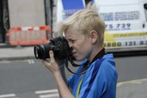 Teen photographing in London