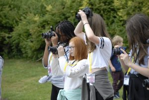 Kids practicing perspective photography on photography course at Waddesdon Manor