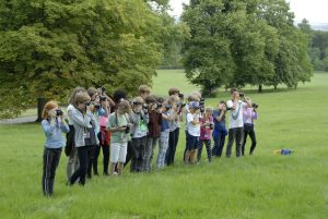 Group photograph of children learning how to pan on Buckinghamshire photography course