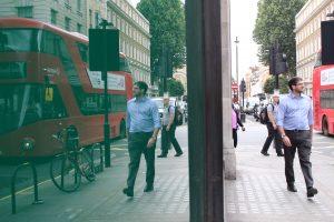 London street scene reflected in shop window