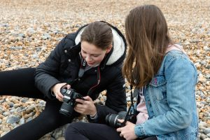 Teenage girls learning photography for their DofE Photography Skills