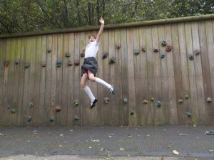 Jumping off climbing wall at after school club
