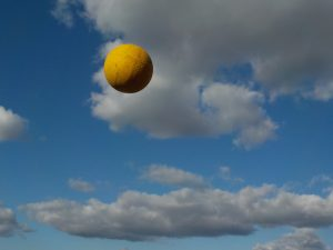 Colourful photograph of ball being thrown in the air
