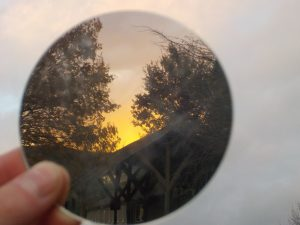 mirror reflecting the sunset behind
