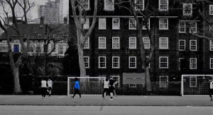 Photo competition winner image of footballers playing in Archbishops Park using fun camera settings