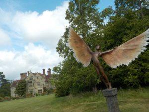 A sculpture standing in the garden